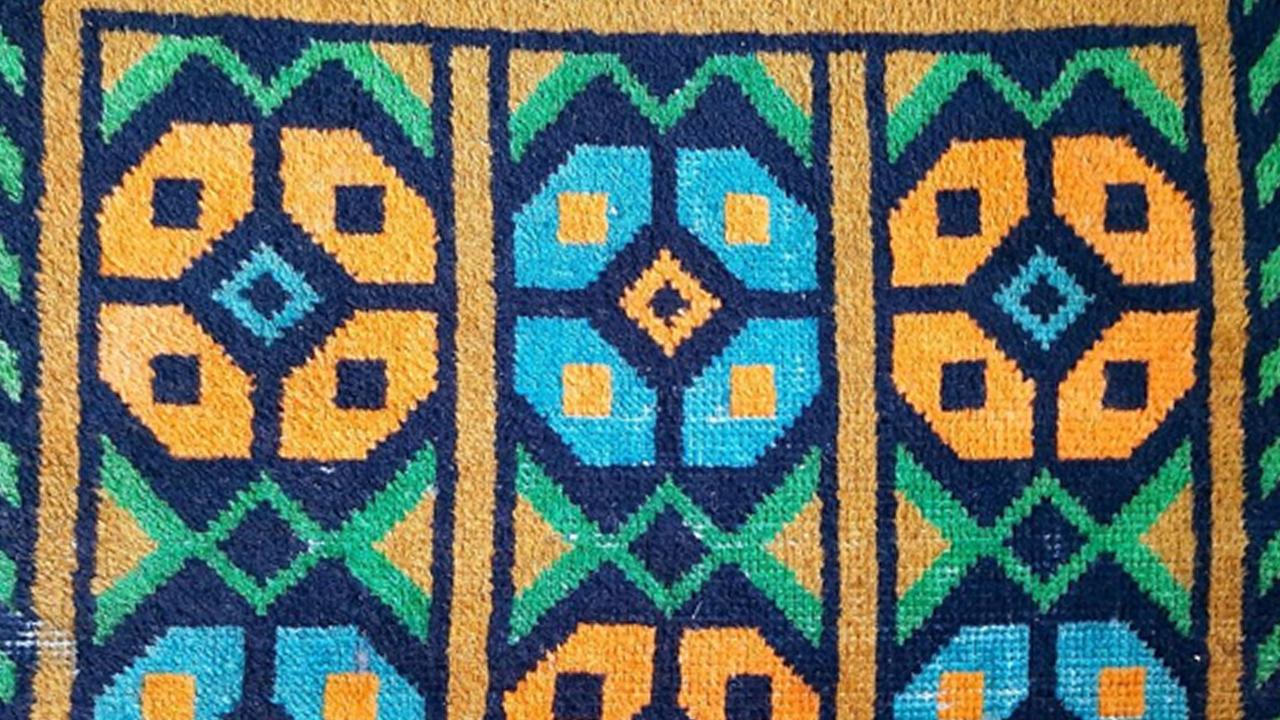 Фрагмент детского коврика Ишимской ковровой фабрики. Подарок победителю соцсоревнования по выращиванию кукурузы, 1963 год,
